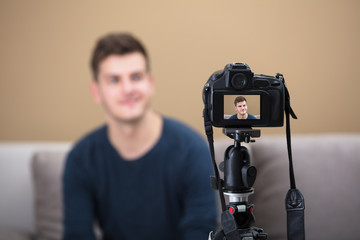 Blogger Recording Video With Camera