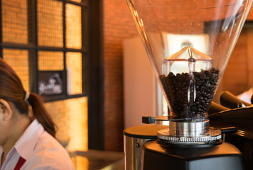 coffee grinder, coffee beans in cafe