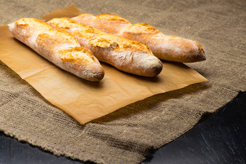 still life with three French fresh bread baguettes with poolish, shallow dof