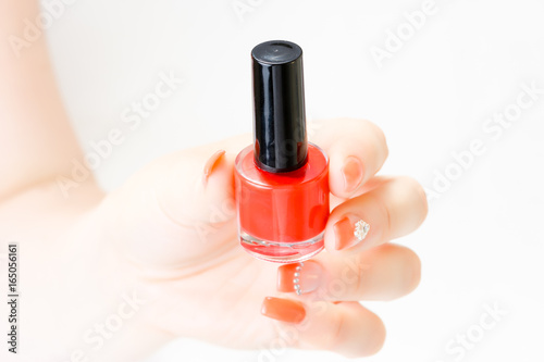 Woman Holding Red Nail Polish In Hand With Nail Art Isolated On