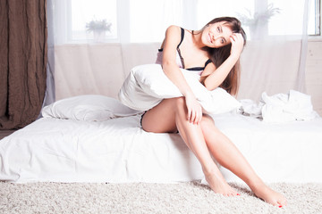 girl in pink underwear on a bed