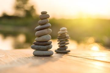 Zen Balancing Pebbles Next to a Misty Lake