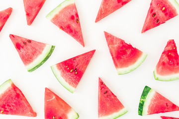 Watermelon pattern made of sliced red watermelon on white background. Flat lay, top view