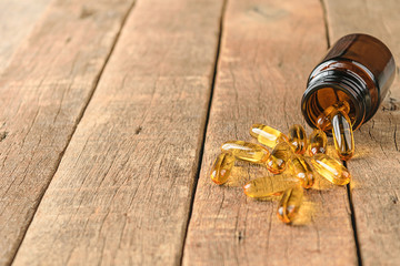 closeup supplements vitamins bottle on wood background, coppy space