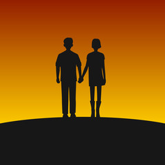 Couple Silhouettes on Sunset Background.