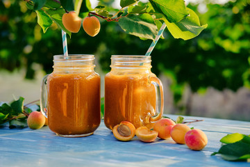 Two glasses of fresh apricot smoothie on the table