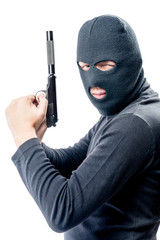 Armed and very dangerous assassin in a balaclava on a white background