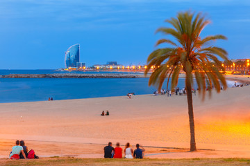 Barceloneta Beach in Barcelona during morning blue hour, Catalonia, Spain.