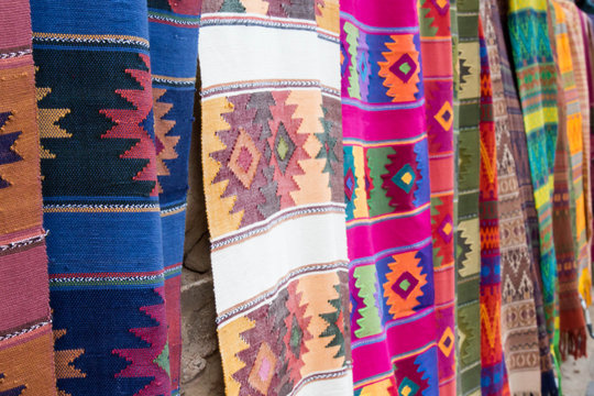 Colorful southwestern blankets hanging