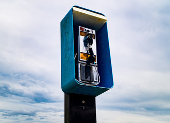 A forgotten, damaged pay phone in rural Louisiana.