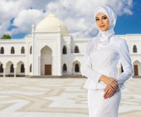 Muslim girl on mosque background