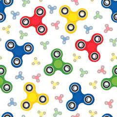 Colorful hand spinners, stress-relieving spinning toy, seamless pattern background.