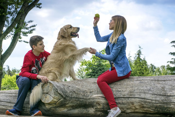 Mother, son and dog playing