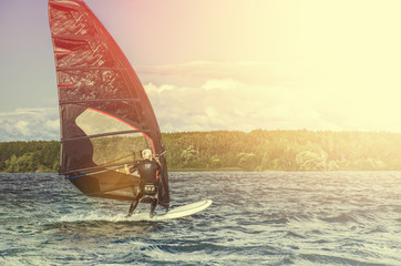 Windsurfer Surfing The Wind On Waves, Recreational Water Sports, Extreme Sport Action. Recreational Sporting Activity. Healthy Active Lifestyle. Summer Fun Adventure. Hobby