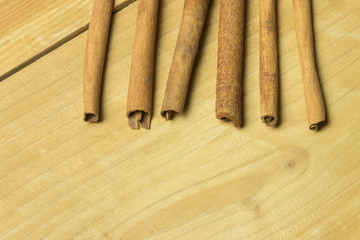 Cinnamon stick on wooden table. copy space. macro