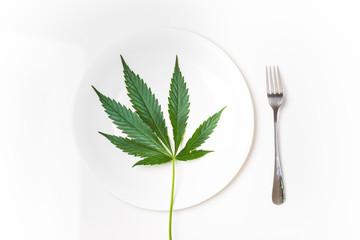 Fresh cannabis leaf on a plate