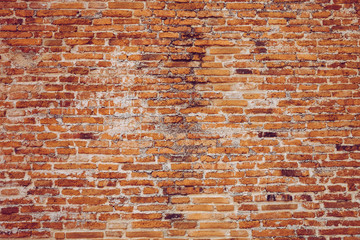 Red old worn brick wall texture background of temple wall. Vintage effect