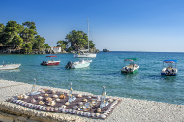 Parga port - Greece - Shell decorations – Ships, Panagia Island and Ionian sea in background