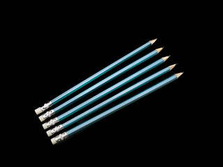 Five Blue Pencils isolated Black background