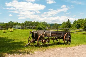 Wooden Wagon in a Field on a Farm