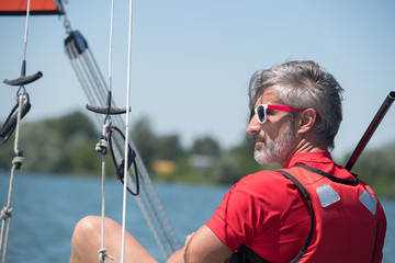 Foto auf AluDibond Segeln Mature man on sailing vessel
