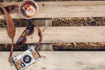 lemonade sunglasses camera on wooden background at summer street food festival flat lay. space for text. summer travel, wanderlust concept. hello summer vacation top view. hipster set