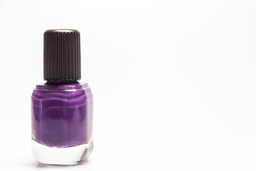 Vial of nail polish on a light background