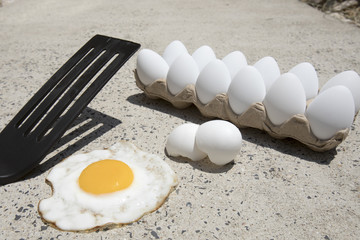 Eggs frying on sidewalk