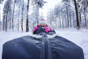 Little girl in a sleigh