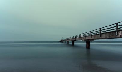 long pier on ocean