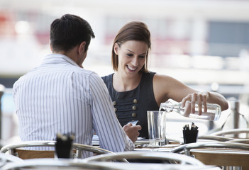 Young professionals meeting in busy cafe or restaurant.
