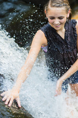 Summertime: Woman Playing in Waterfall