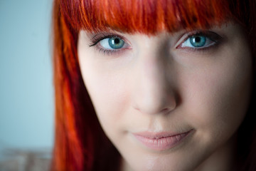 Close up of young woman with red hair