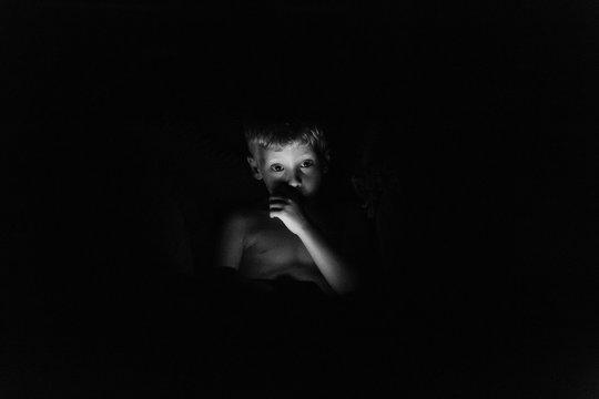 Boy with iPad in the Dark