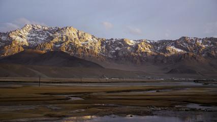 Pamir mountains caught in evening sunlight.