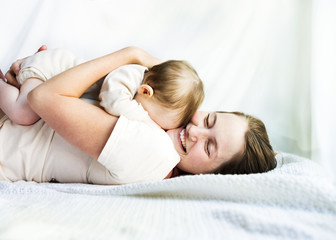 Mother, embracing a tired baby