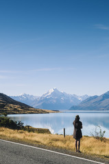 Woman looking towards Aoraki / Mt Cook, the highest mountain in New Zealand.