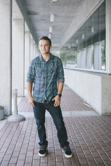 Casual Young Man Standing in Walkway