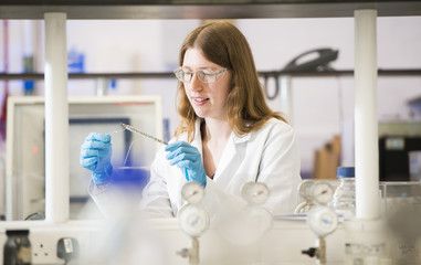 Woman conducting research in a science lab