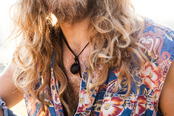 Close up of a young male hippie.