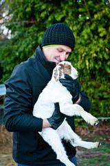 a man holds a pet goat