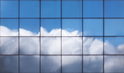 The Sky Reflected on an Office Building