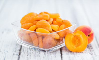 Dried Apricots (selective focus) on vintage wooden background