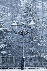 Old Street Lamp in a Snowy Day