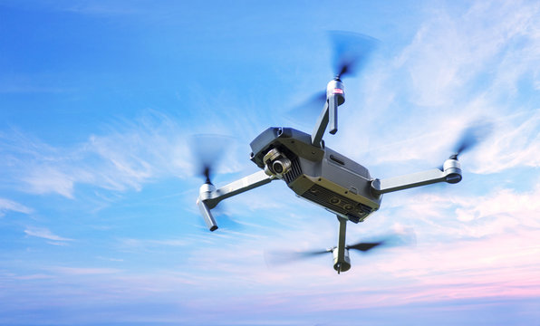 Drone in Flight over a blue sky background