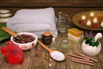 Spa still life with candles, spa products and hibiscus flower.