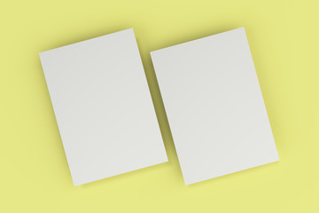 Blank white flyer mockup on yellow background