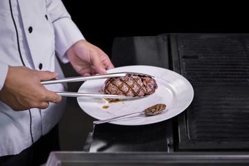 Chef cooking beef steak
