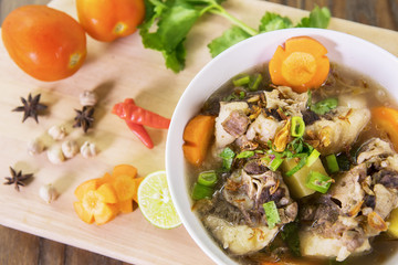 Indonesian oxtail soup on table