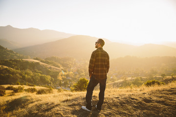 Man in nature looking out at view